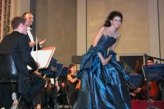 Lucia Aliberti with the conductor Oleg Caetani⚘Concert⚘Festival Taormina Arte⚘Orchestra Sinfonica Di Milano G.Verdi⚘Greek Theatre⚘Taormina⚘Photo taken from the TV⚘Rai1 Portrait⚘On Stage⚘Escada Fashion⚘:http://www.luciaaliberti.it #luciaaliberti #olegcaetani #festivaltaorminaarte #orchestrasinfonicadimilanogiuseppeverdi #concert #taormina #onstage #escadafashion